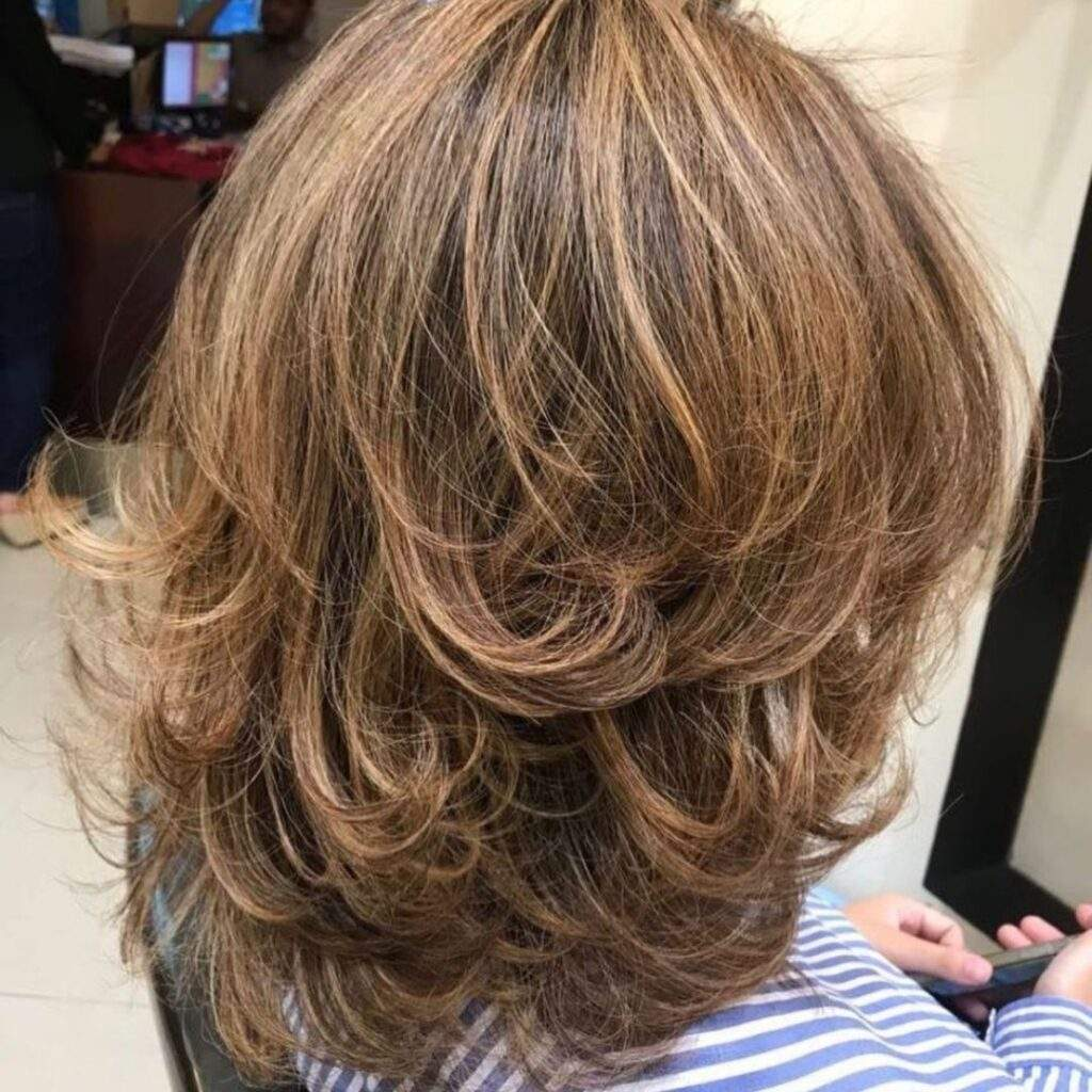 Flicked Out Short Hairstyle With Highlights
